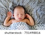 new baby boy sleeping covered... | Shutterstock . vector #751498816