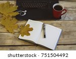 workplace with coffee  laptop ... | Shutterstock . vector #751504492