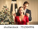 sweet guy gifting a precious... | Shutterstock . vector #751504996