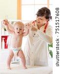 pediatrician doctor examining... | Shutterstock . vector #751517608