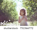 kid having fun outdoors | Shutterstock . vector #751566772