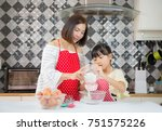 asian happy family in the... | Shutterstock . vector #751575226