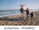 happy family walking together... | Shutterstock . vector #751608022
