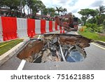 Small photo of KUALA LUMPUR MALAYSIA -9 NOVEMBER 2017: After a downpour, a giant sinkhole had swallowed traffic lights and cut off power in Kuala Lumpur.