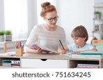 female private tutor helping... | Shutterstock . vector #751634245