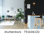 Small photo of Black and grey lounge area with kitchen annex