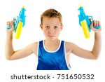 Pre-teen boy playing with water pistols isolated on a white background - stock photo
