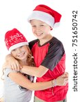 Happy siblings embrance for christmas isolated on white background - stock photo