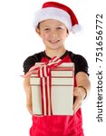 Happy pre-teen boy with a christmas gift isolated on white background - stock photo