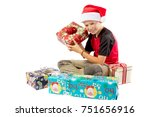 Happy pre-teen boy with a pile of christmas gifts isolated on white background - stock photo