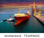 a tugs boat assist container... | Shutterstock . vector #751694632