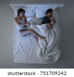 couple sleeping in bed  the man ... | Shutterstock . vector #751709242