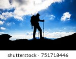 hiker silhouette with backpack... | Shutterstock . vector #751718446