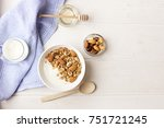 bowl of whole grain muesli with ... | Shutterstock . vector #751721245