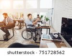 a man in a wheelchair is... | Shutterstock . vector #751728562