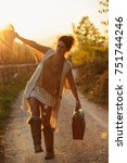 woman on the contry side road... | Shutterstock . vector #751744246