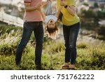 cheerful young parents have fun ... | Shutterstock . vector #751762222