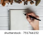 female hands with pen writing... | Shutterstock . vector #751766152