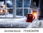 Small photo of Table with space for your product or advertising tex. Candle lamp giving warm light. Window overlooking the winter mountains and the moon in the sky.