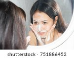 asian woman wash face with foam ... | Shutterstock . vector #751886452