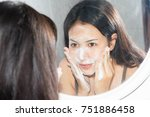 asian woman wash face with foam ... | Shutterstock . vector #751886458
