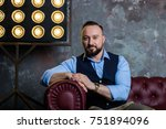 stylish man with a beard and a... | Shutterstock . vector #751894096