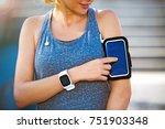female runner with mobile phone ... | Shutterstock . vector #751903348