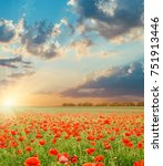 sunset in clouds over field... | Shutterstock . vector #751913446