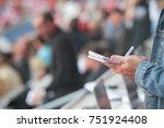 somebody write in his noticebook | Shutterstock . vector #751924408
