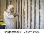 worker spraying closed cell... | Shutterstock . vector #751941928