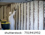 worker spraying closed cell...   Shutterstock . vector #751941952