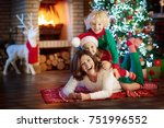 family with kids at christmas... | Shutterstock . vector #751996552