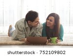 couple lying on floor looking... | Shutterstock . vector #752109802