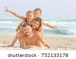 happy family on sea beach at... | Shutterstock . vector #752133178