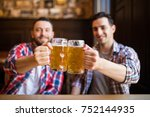 having a pint with friend. two... | Shutterstock . vector #752144935
