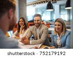 businesspeople talking with a... | Shutterstock . vector #752179192