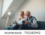 elderly couple holding a... | Shutterstock . vector #752182942