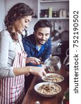 young couple cooking. man and... | Shutterstock . vector #752190502