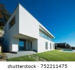 modern white villa with garden | Shutterstock . vector #752211475