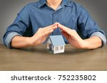 hand holding house  home real...   Shutterstock . vector #752235802