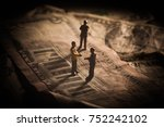 a shady business deal depicted... | Shutterstock . vector #752242102