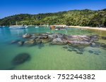 Small photo of Crystal clear water in tropical beach in Ilha Grande (Grande Island) in south Rio de Janeiro, Brazil