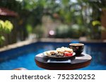 served breakfast by the pool on ... | Shutterstock . vector #752320252