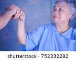 Small photo of Holding hands Asian senior or elderly old woman patient with love, care, encourage and empathy at hospital.
