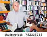 mature american man is... | Shutterstock . vector #752338366