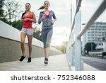 active female joggers running...   Shutterstock . vector #752346088