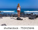 a young woman standing on the... | Shutterstock . vector #752415646