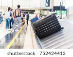 suitcase on luggage conveyor... | Shutterstock . vector #752424412