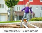 cute little girl having fun on... | Shutterstock . vector #752452432