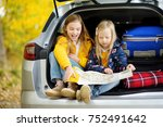 two adorable girls sitting in a ... | Shutterstock . vector #752491642